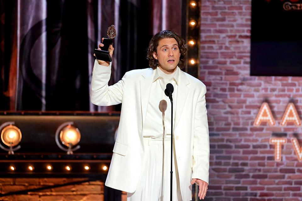 """<p>Despite being the only nominee for Best Leading Actor in a Musical, it wasn't completely guaranteed that <a href=""""https://ew.com/tag/aaron-tveit/"""" rel=""""nofollow noopener"""" target=""""_blank"""" data-ylk=""""slk:Aaron Tveit"""" class=""""link rapid-noclick-resp"""">Aaron Tveit</a> would <a href=""""https://ew.com/awards/tony-awards/aaron-tveit-wins-tony-moulin-rogue/"""" rel=""""nofollow noopener"""" target=""""_blank"""" data-ylk=""""slk:take home his first Tony"""" class=""""link rapid-noclick-resp"""">take home his first Tony</a>, due to an arcane rule requiring him to receive at least 60 percent of the votes to win. The actor became visibly emotional during his acceptance speech, thanking """"a group of people who, many years ago, took a chance on me"""" — the creative team of the musical <em>Catch Me If You Can</em>, including the late playwright Terrence McNally, who <a href=""""https://ew.com/theater/terrence-mcnally-playwright-dies-coronavirus-complications/"""" rel=""""nofollow noopener"""" target=""""_blank"""" data-ylk=""""slk:died of complications from COVID-19"""" class=""""link rapid-noclick-resp"""">died of complications from COVID-19</a> last year. """"We are so privileged to do this,"""" Tveit said, holding back tears. """"Let us continue to strive to tell the stories that represent the many, and not the few.""""</p>"""