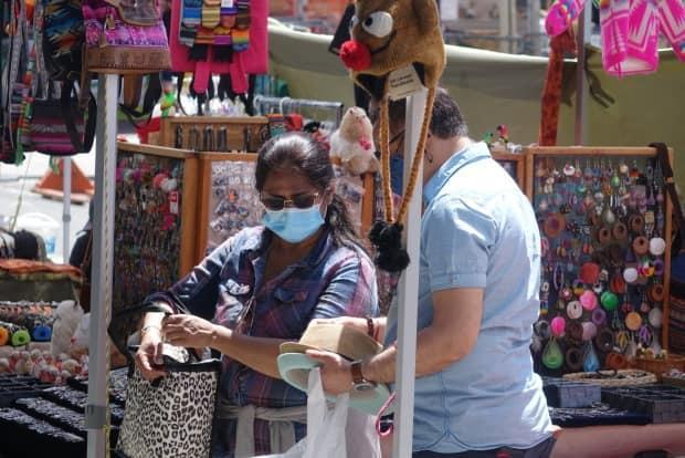 A woman wearing a mask shops at the ByWard Market in early July 2021. On Sunday, health officials in the nation's capital reported just one case of COVID-19. (Joseph Tunney/CBC - image credit)