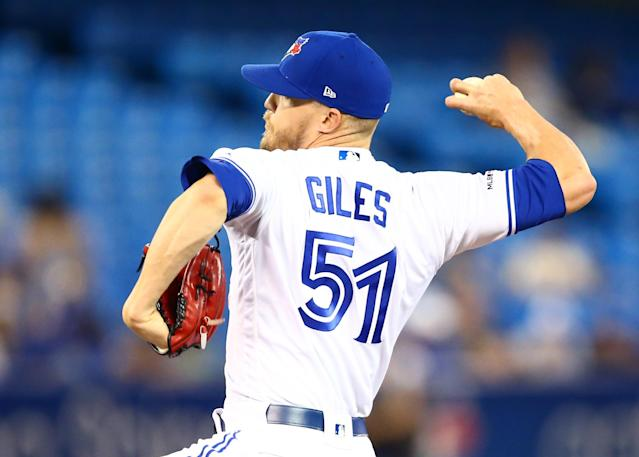 TORONTO, ON - JULY 23: Ken Giles #51 of the Toronto Blue Jays delivers a pitch in the tenth inning during a MLB game against the Cleveland Indians at Rogers Centre on July 23, 2019 in Toronto, Canada. (Photo by Vaughn Ridley/Getty Images)