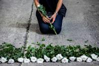 An artist in Hong Kong mourns the victims of China's deadly Tiananmen Square crackdown after authorities banned an annual vigil and vowed to stamp out any protests on the June 4 anniversary