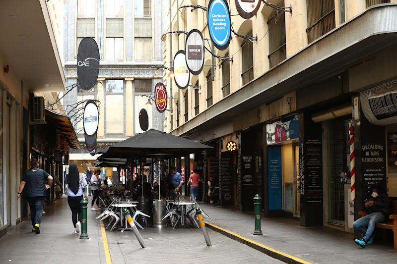 MELBOURNE, AUSTRALIA - MARCH 22: A view of Degraves Street on March 22, 2020 in Melbourne, Australia. Prime Minister Scott Morrison on Friday introduced further measures to help stop the spread of COVID-19, implementing new rules limiting the number of people inside a venue to one every 4 square metres. Non-essential gatherings of 100 or more people indoors are banned, along with outdoor gatherings of more than 500 people in a bid to contain the spread of COVID-19. A travel ban on all visitors who are not Australian citizens or residents or their direct relations arriving into the country is now in place. There are now 1081 confirmed cases of COVID-19 In Australia and the death toll now stands at seven. (Photo by Robert Cianflone/Getty Images)