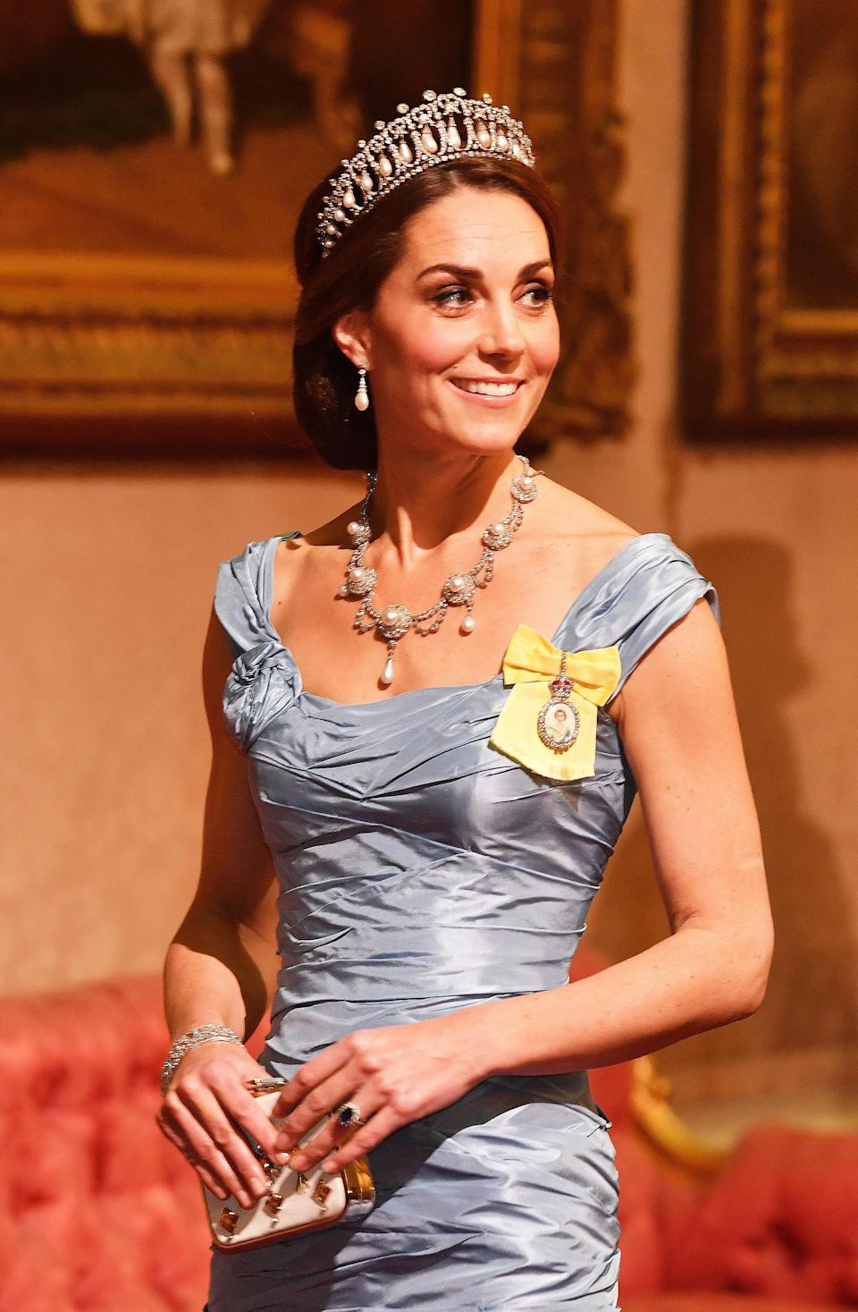 The Duchess wore the Lover's Knot tiara and Princess Diana's Collingwood pearl and diamond earrings, with a blue Alexander McQueen gown for the Netherlands State Banquet in October 2018. The Queen also loaned her Queen Alexandra's Wedding Necklace, which dates back to 1863 (PA)