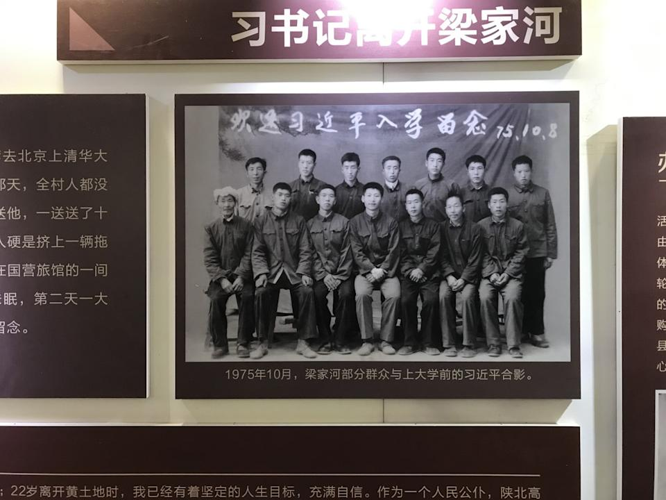 A photo shows a young Xi Jinping sitting in the center of the front row, surrounded by villagers.