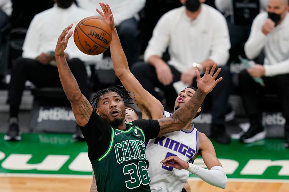 Boston Celtics guard Marcus Smart (36) competes for a rebound with Sacramento Kings guard Tyrese Haliburton (0) in a March 19, 2021 game.