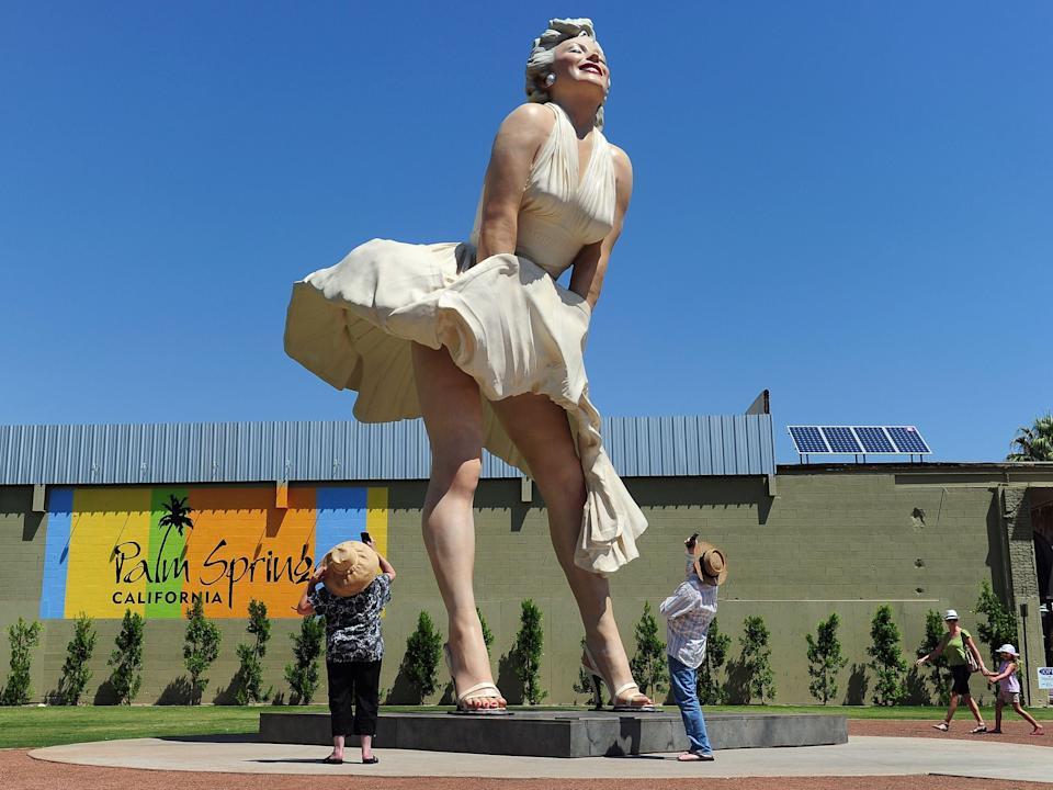 People visit and photograph the 'Forever Marilyn' statue of actress Marilyn Monroe in Palm Springs, California, on 4 August 2012AFP via Getty Images