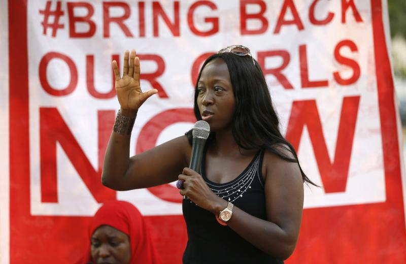 "A member gestures while addressing a sit-in demonstration organized by the Abuja ""Bring Back Our Girls"" protest group at the Unity Fountain in Abuja"