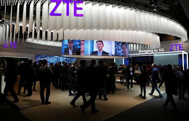 FILE PHOTO: People stand at ZTE's booth during Mobile World Congress in Barcelona, Spain, February 27, 2017. REUTERS/Paul Hanna/File Photo