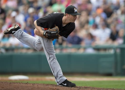 Miami Marlins pitcher Wade LeBlanc follows through with a pitch during the first inning of an exhibition spring training baseball game against the Atlanta Braves on Sunday, March 10, 2013, in Kissimmee, Fla. (AP Photo/Evan Vucci)