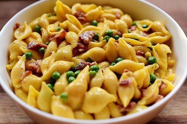 """<p>Take inspiration from Ree's shells and cheese recipe and top prepared mac and cheese with diced cooked bacon and peas. If you're feeling fancy, you can even turn it into a quick twist on <a href=""""https://www.thepioneerwoman.com/food-cooking/recipes/a10649/pasta-carbonara/"""" rel=""""nofollow noopener"""" target=""""_blank"""" data-ylk=""""slk:pasta carbonara"""" class=""""link rapid-noclick-resp"""">pasta carbonara</a> by adding a fried egg.</p><p><strong>Get <a href=""""https://www.thepioneerwoman.com/food-cooking/recipes/a11827/shells-cheese-and-bacon-and-peas/"""" rel=""""nofollow noopener"""" target=""""_blank"""" data-ylk=""""slk:Ree's recipe"""" class=""""link rapid-noclick-resp"""">Ree's recipe</a> for shells and cheese.</strong></p>"""