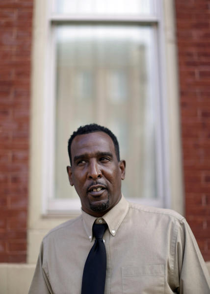 "In this April 1, 2013 photo, Antonio Hammond stands outside of his apartment in Baltimore. Hammond arrived in Baltimore three years ago, addicted to crack cocaine and snorting heroin, living in abandoned buildings where ""the rats were fierce,"" and financing his addiction by breaking into cars and stealing copper pipes out of crumbing structures. Eighteen months after finding his way to Catholic Charities via a rehabilitation center, the 49-year-old Philadelphia native is clean of drugs, earning $13 an hour and paying taxes. But such success stories are in danger as $85 billion in federal government spending cuts that began last month begin squeezing services for the poor nationwide. (AP Photo/Patrick Semansky)"