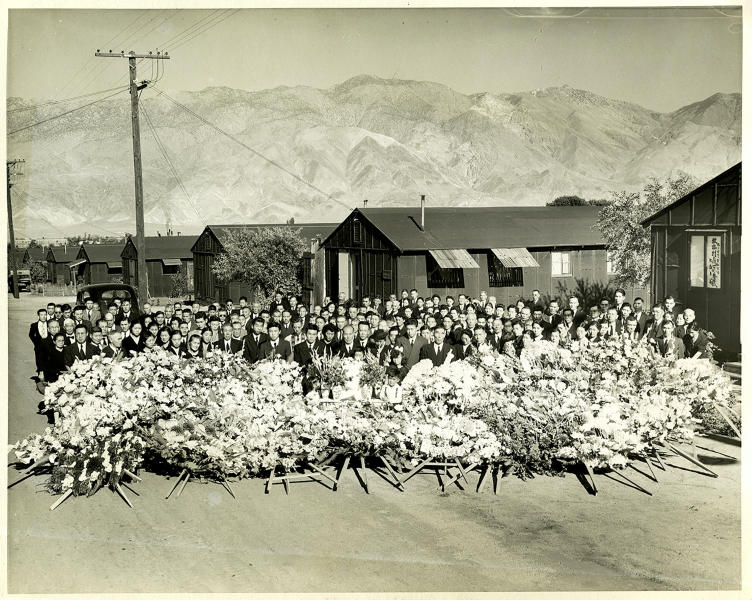 CORRECTS SOURCE TO TOYO MIYATAKE STUDIO - This 1945 photo provided by the Toyo Miyatake Studio shows a memorial service for Giichi Matsumura, who died on nearby Mount Williamson during his incarceration at an internment camp for people of Japanese ancestry in Manzanar, Calif., during World War II. A skeleton found by hikers this fall near California's second-highest peak was identified Friday, Jan. 3, 2020, as Matsumura, a Japanese American artist who had left the Manzanar internment camp to paint in the mountains in the waning days of World War II. (Toyo Miyatake Studio via AP)