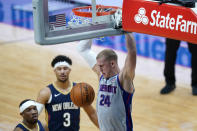 Detroit Pistons center Mason Plumlee (24) dunks next to New Orleans Pelicans guards Eric Bledsoe and Josh Hart (3) during the first half of an NBA basketball game in New Orleans, Wednesday, Feb. 24, 2021. (AP Photo/Gerald Herbert)