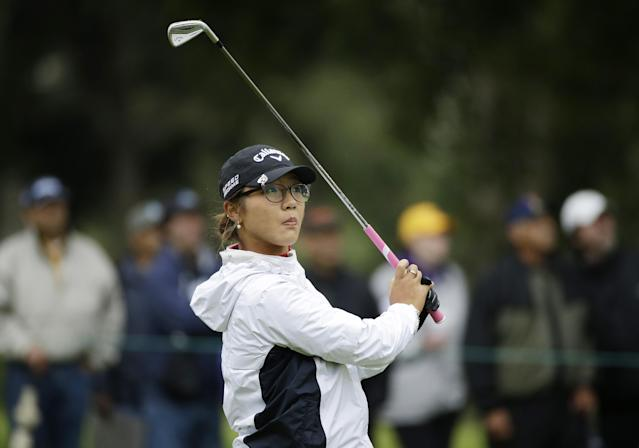 Lydia Ko of New Zealand follows her shot from the fairway to the first green of the Lake Merced Golf Club during the second round of the Swinging Skirts LPGA Classic golf tournament Friday, April 25, 2014, in Daly City, Calif. (AP Photo/Eric Risberg)
