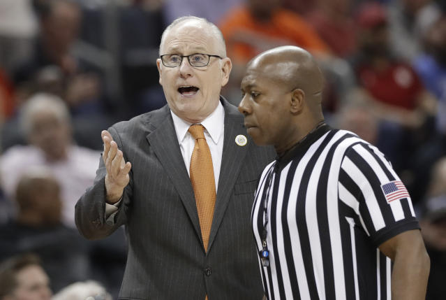 Miami head coach Jim Larranaga, left, talks to an official during the first half of an NCAA college basketball game against Virginia Tech in the Atlantic Coast Conference tournament in Charlotte, N.C., Wednesday, March 13, 2019. (AP Photo/Chuck Burton)