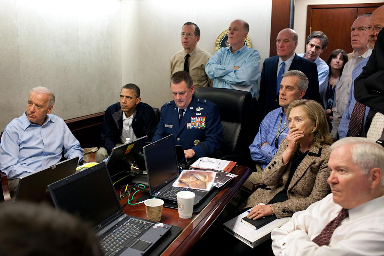 <p>In a conference room of the White House Situation Room on May 1, 2011, President Obama and the national security team monitor in real time the mission against Osama bin Laden. The president sits next to Brig. Gen. Marshall B. Webb, assistant commanding general of Joint Special Operations Command. Seated in this picture from left to right: Vice President Joe Biden, the president, Brig. Gen. Webb, Deputy National Security Advisor Denis McDonough, Secretary of State Hillary Rodham Clinton and Secretary of Defense Robert Gates. Standing, from left, are: Admiral Mike Mullen, Chairman of the Joint Chiefs of Staff; National Security Advisor Tom Donilon; Chief of Staff Bill Daley; Tony Blinken, national security adviser to the pice president; Audrey Tomason, director for counterterrorism; John Brennan, assistant to the president for Homeland Security and Counterterrorism; and Director of National Intelligence James Clapper. (Photo: Pete Souza/White House) </p>