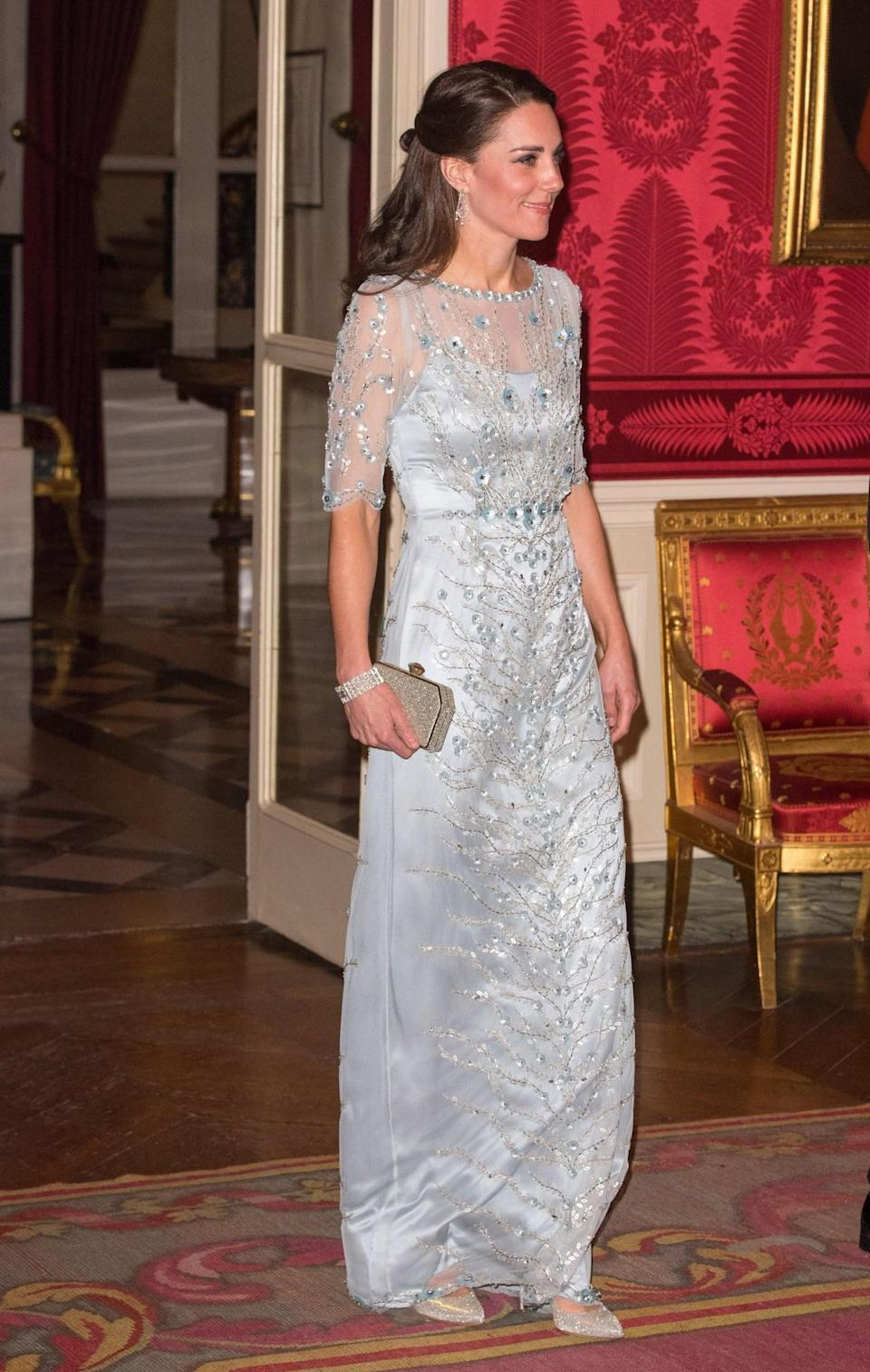 <p>Black tie dinners are always Kate's time to shine. For such an occasion in Paris, the Duchess was spotted in a gorgeous bespoke Jenny Packham gown. The silvery design featured sheer sleeves and beaded floral embellishing. A glittering clutch (also by Jenny Packham) was carried with sparkly Oscar de la Renta pumps topping off the princess-worthy ensemble.<br><i>[Photo: PA</i> </p>