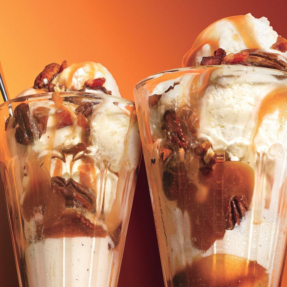 """Meet your new favorite sundae: Ice cream topped with a sweet and salty maple-bacon sauce and sprinkled with toasted pecans. <a href=""""https://www.epicurious.com/recipes/food/views/maple-pecan-sundaes-with-candied-bacon-361274?mbid=synd_yahoo_rss"""" rel=""""nofollow noopener"""" target=""""_blank"""" data-ylk=""""slk:See recipe."""" class=""""link rapid-noclick-resp"""">See recipe.</a>"""
