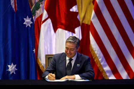 Canada's International Trade Minister Francois-Phillippe Champagne signs the Trans-Pacific Partnership (TPP) trade deal, in Santiago