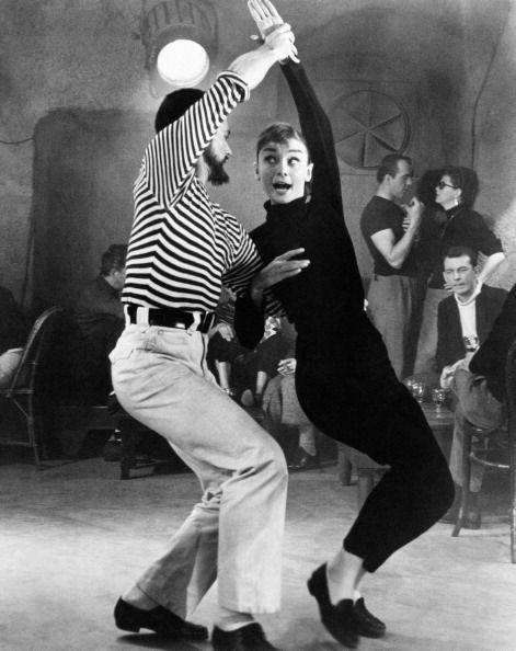 <p>Audrey Hepburn danced in a pair of black loafers in <em>Funny Face</em>. She rounded out the iconic look with a black turtleneck and cigarettes pants.</p>
