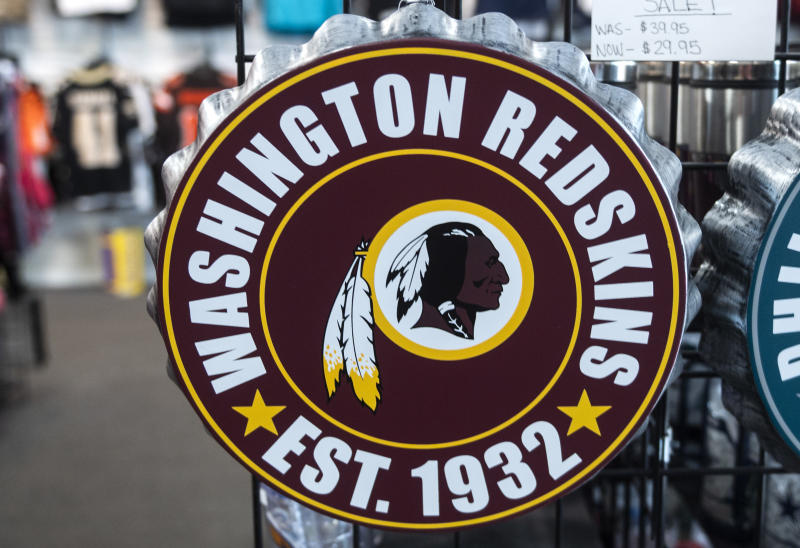 Washington Redskins merchandise is seen for sale at a sports store in Fairfax, Virginia on July 13, 2020. - The Washington Redskins confirmed on July 13 that the team is changing its name following pressure from sponsors over a word widely criticized as a racist slur against Native Americans. (Photo by ANDREW CABALLERO-REYNOLDS / AFP) (Photo by ANDREW CABALLERO-REYNOLDS/AFP via Getty Images)