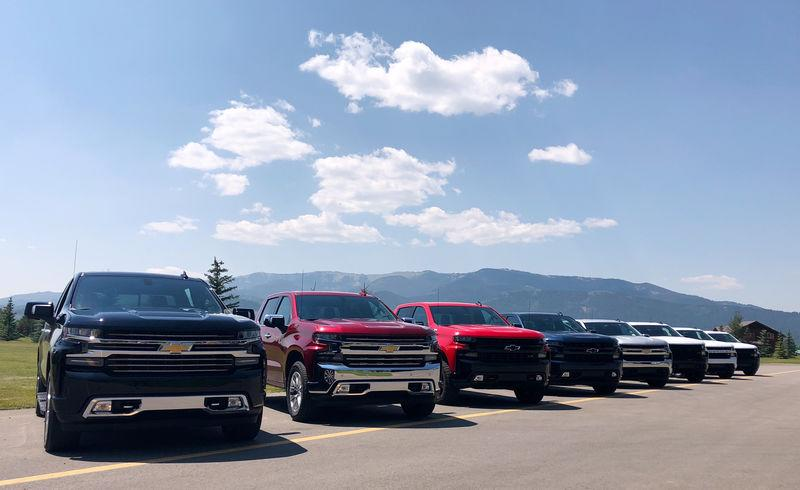 FILE PHOTO: Eight versions of GM's new generation Chevrolet Silverado pickups are lined up at an event near Alpine