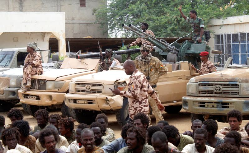 Captured FACT rebels and vehicles are pictured at army headquarters in N'Djamena