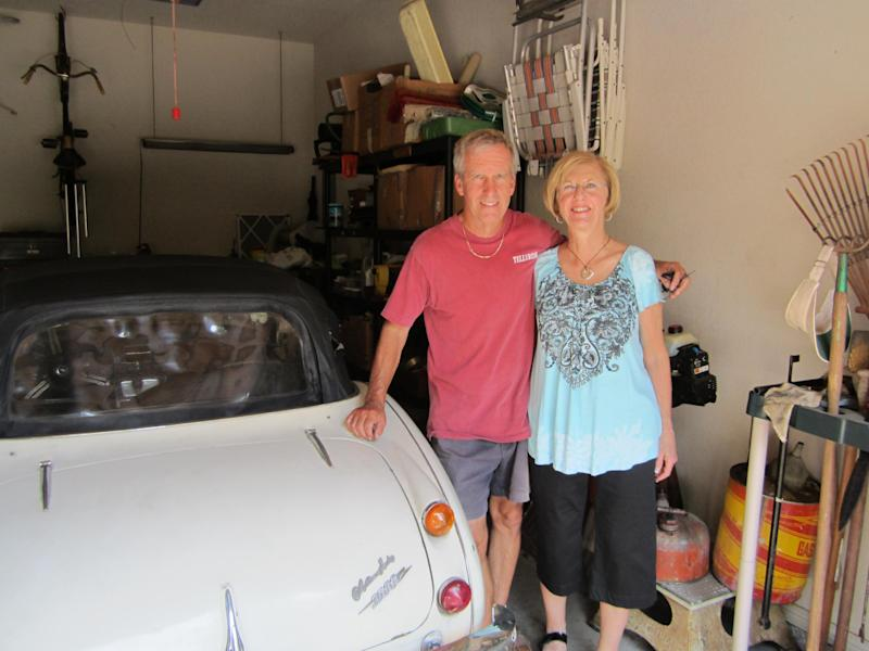 In this image provided by the Los Angeles County Sheriff's Department Mr. & Mrs. Russell with car back in their Texas garage after it was delivered to Robert Russell 's home in Texas. Russell whose prized 1967 Austin Healy sports car was stolen 42 years ago, recovered the vehicle after spotting it on eBay, authorities said Sunday July 15, 2012. (AP Photo/Los Angeles County Sheriff's Department)