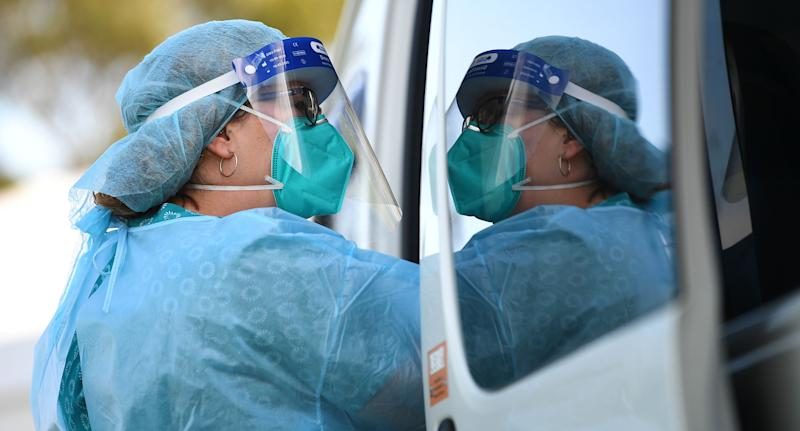 Pictured is a healthcare worker with a mask at a pop-up coronavirus testing facility in Clyde, Melbourne, Friday, September 18, 2020.