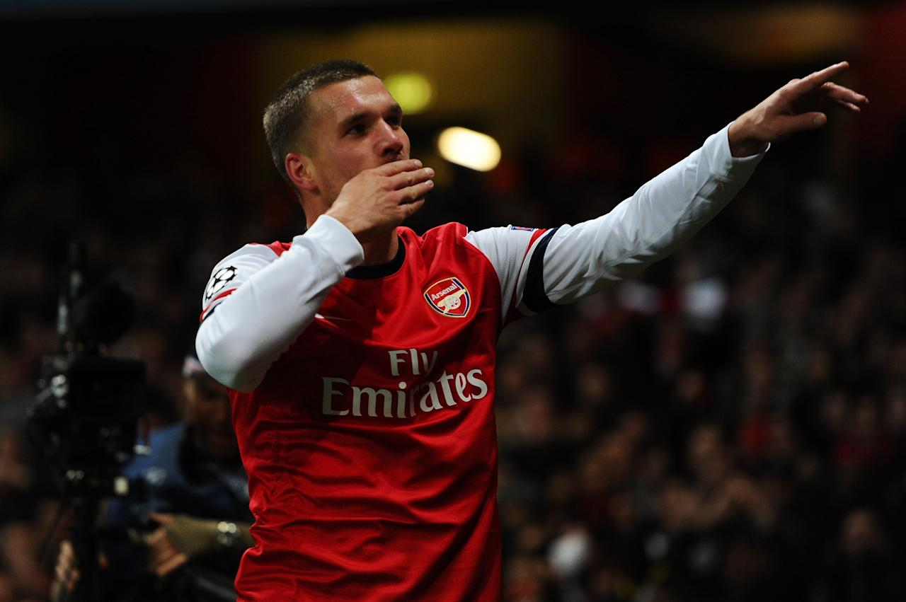 LONDON, ENGLAND - NOVEMBER 21:  Lukas Podolski of Arsenal celebrates scoring their second goal during the UEFA Champions League group B match between Arsenal FC and Montpellier Herault SC at Emirates Stadium on November 21, 2012 in London, England.  (Photo by Mike Hewitt/Getty Images)
