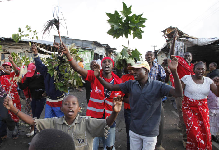 Supporters of Kenyan presidential candidate Uhuru Kenyatta celebrate what they perceive is an election win for him in Nairobi, Kenya Saturday, March 9, 2013. Kenya's election commission posted complete results early Saturday showing that Deputy Prime Minister Uhuru Kenyatta prevailed in the country's presidential elections by the slimmest of margins, winning 50.03 percent of the vote.(AP Photo/Sayyid Azim)