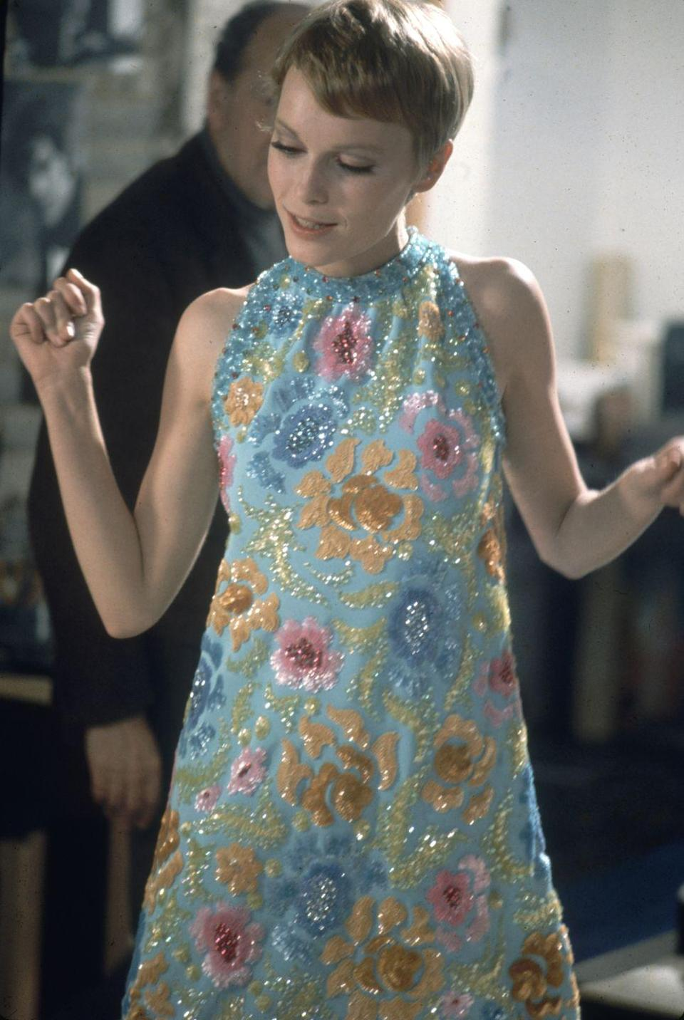 <p>Farrow dons a high-neck sequin mini dress in her film <em>A Dandy in Aspic</em>. The spy film, which she costarred in with Laurence Harvey, was released in 1968.</p>