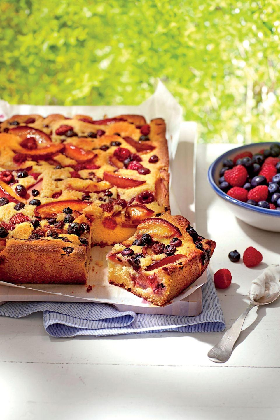 """<p><strong>Recipe: </strong><a href=""""https://www.southernliving.com/syndication/plum-berry-cornmeal-sheet-cake"""" rel=""""nofollow noopener"""" target=""""_blank"""" data-ylk=""""slk:Plum-Berry Cornmeal Sheet Cake"""" class=""""link rapid-noclick-resp""""><strong>Plum-Berry Cornmeal Sheet Cake</strong></a></p> <p>Use any kind of mixed fresh berries you choose, just keep the amount the same as is specified in the ingredient list. As the cake bakes, the batter nestles around all the fresh fruit, cooking it just enough to ensure each bite is bursting with gorgeous, fruity flavor.</p>"""