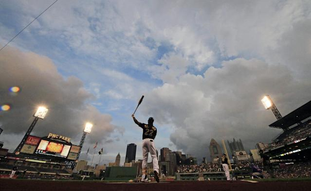Pittsburgh Pirates' Andrew McCutchen (22) warms up on-deck during the first inning of a baseball game against the Chicago Cubs in Pittsburgh, Thursday, Sept. 12, 2013. (AP Photo/Gene J. Puskar)