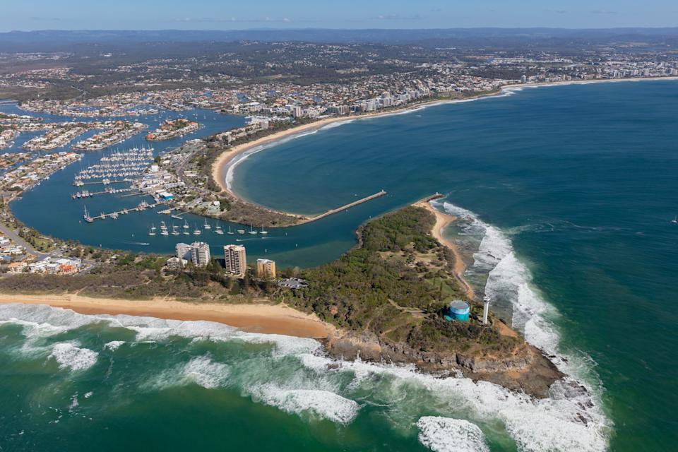 Bright summers day aerial view of coastal area. Port Cartwright provides a sheltered bay for many pleasure boats on the Sunshine Coast, as well sandy surf beaches for residents and holiday makers.