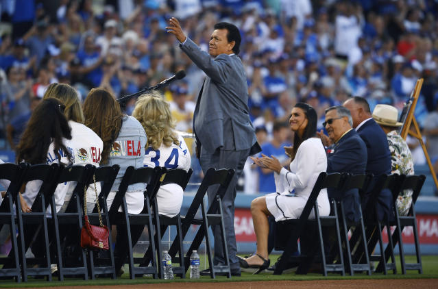 "Former Los Angeles Dodgers pitcher Fernando Valenzuela waves to fans as he is inducted into the ""Legends of Dodger Baseball"" prior to a baseball game against the Miami Marlins Saturday, July 20, 2019, in Los Angeles. (AP Photo/Mark J. Terrill)"