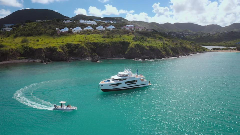 """<p>The gorgeous <a href=""""https://virgincharteryachts.com/yachts/angeleyes"""" class=""""link rapid-noclick-resp"""" rel=""""nofollow noopener"""" target=""""_blank"""" data-ylk=""""slk:Angeleyes Yacht"""">Angeleyes Yacht</a> in St. Martin is one of the most luxurious, spacious yachts you can vacation in. It has five bedrooms, five bathrooms, and four crew members that offer one-of-a-kind service to guests for $81,400 a week. It has world-class amenities, stunning views of the blue water, a hot tub, and plenty of water sports to stay entertained. Split it with your friends for a more affordable way to book this dream vacation!</p>"""