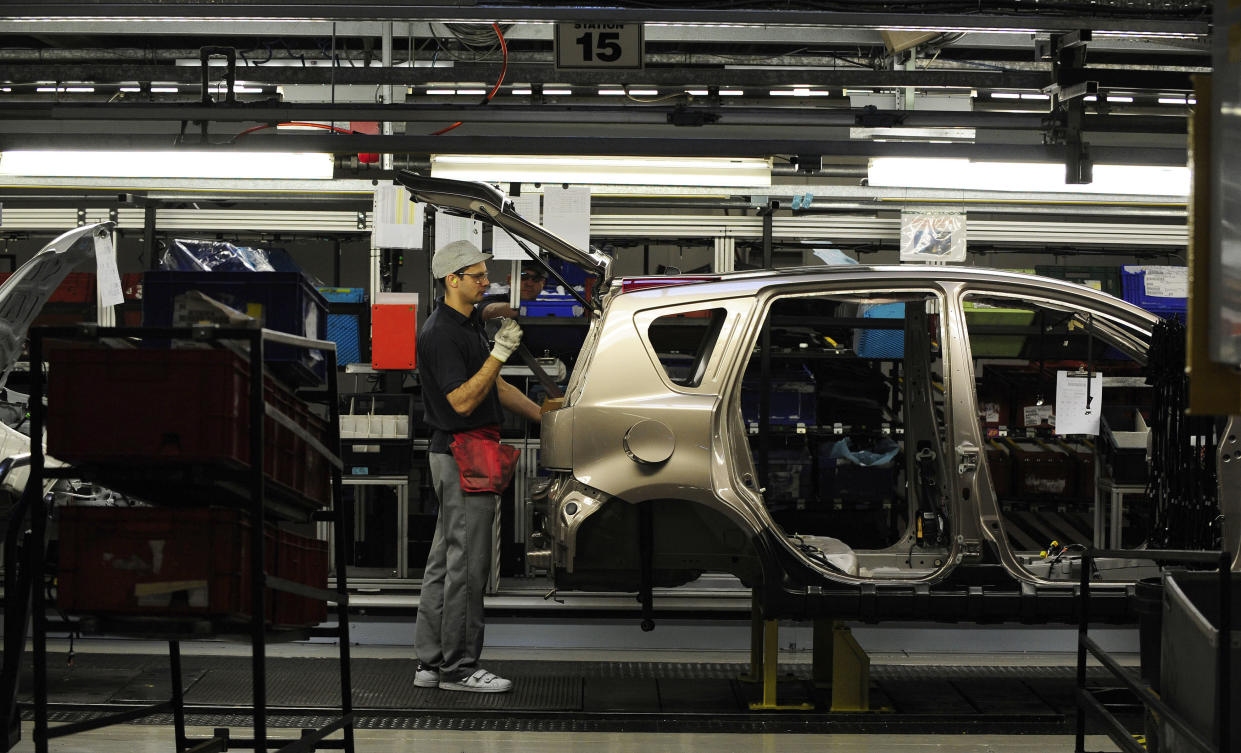 An employee works on the production line at the Nissan car factory in Washington, northern England. Photo: Nigel Roddis/Reuters
