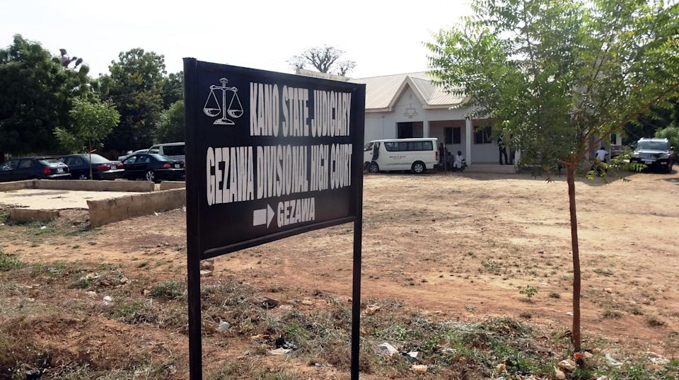 A signpost points to the Kano state High court in the village of Gezawa outside Kano, where 14-year old Wasila Tasi'u is standing trial for the murder of her husband (AFP Photo/Aminu Abubakar)
