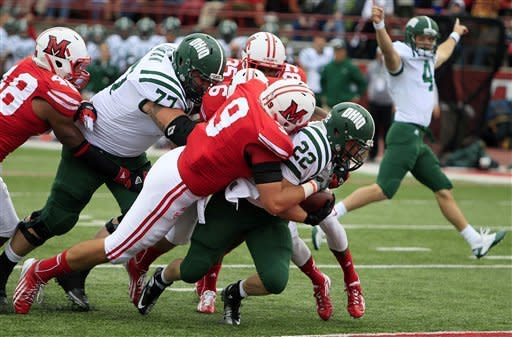 Ohio running back Beau Blankenship (22) runs past Miami (Ohio) defensive lineman Wes Williams (9) for a five-yard touchdown in the first half of an NCAA college football game, Saturday, Oct. 27, 2012, in Oxford, Ohio. Ohio quarterback Tyler Tettleton (4) celebrates at right. (AP Photo/Al Behrman)