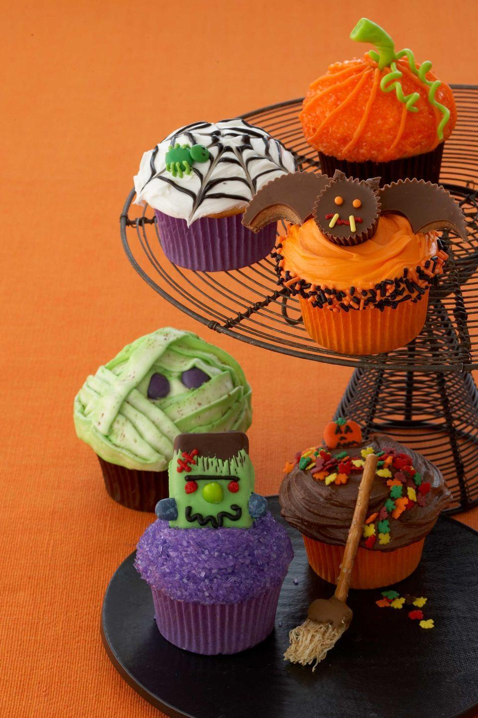 """<p>Make any Halloween party more festive with these so-simple treats resembling spider webs, pumpkins, and more.</p><p><a href=""""https://www.womansday.com/food-recipes/food-drinks/recipes/a10778/creepy-cupcakes-recipe-122165/"""" rel=""""nofollow noopener"""" target=""""_blank"""" data-ylk=""""slk:Get the Creepy Cupcakes recipe."""" class=""""link rapid-noclick-resp""""><em>Get the Creepy Cupcakes recipe.</em></a></p>"""
