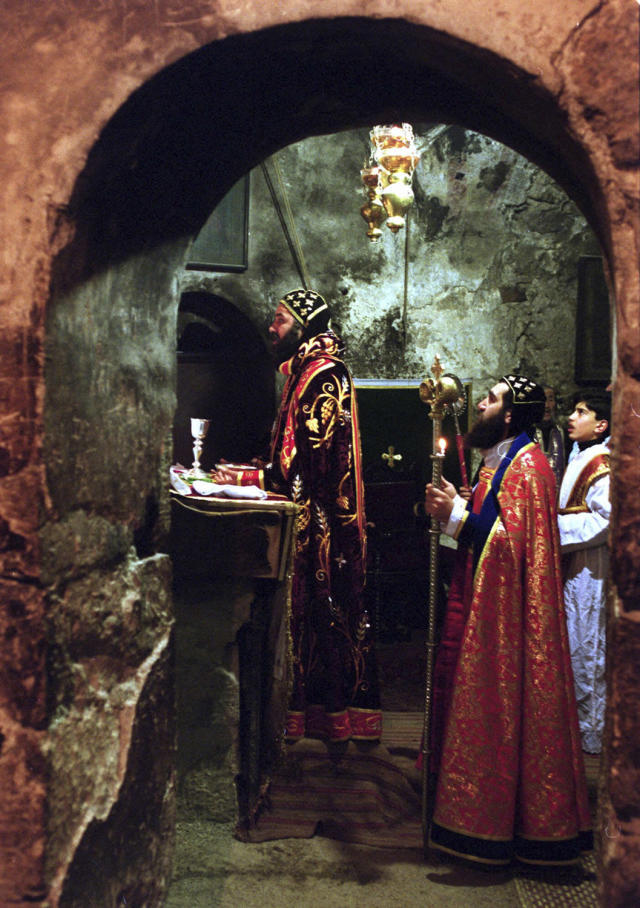 <p>Metropolitan Mar Sewerios Malki Murad, left, the top Syrian Orthodox cleric in the Holy Land, conducts a Sunday service in the Church of the Holy Sepulcher in Jerusalem, Jan. 30, 2000. (Photo: Jacqueline Larma/AP) </p>