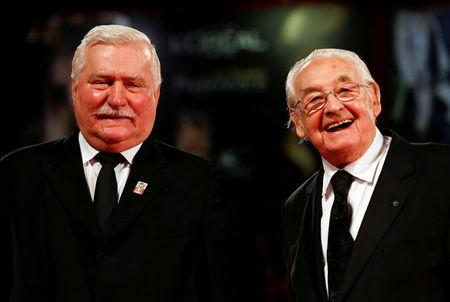 "Former Polish President Lech Walesa (L) poses with director Andrzej Wajda (R) during a red carpet for the movie ""Walesa, Man of Hope"" during the 70th Venice Film Festival in Venice September 5, 2013. Wajda died Sunday night aged 90, according to local media. REUTERS/Alessandro Bianchi/File Photo"