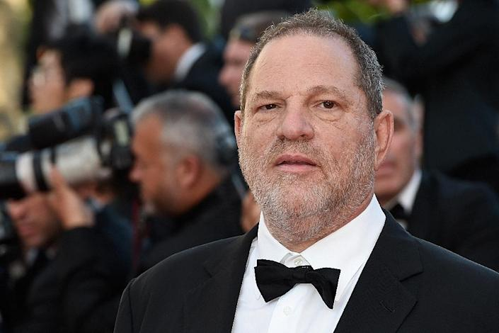 Harvey Weinstein, whose career went down in flames over an avalanche of sexual abuse accusations, surrendered to New York police (AFP Photo/LOIC VENANCE)