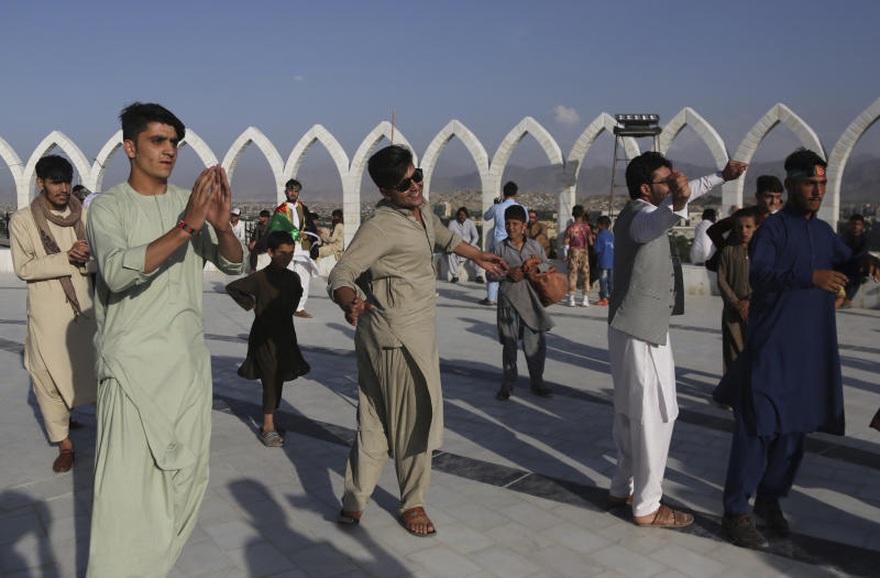 Afghans dance during Independence Day celebrations in Kabul, Afghanistan, Monday, Aug. 19, 2019. Afghanistan's president vowed to eliminate all safe havens of the Islamic State group as the country marks a subdued 100th Independence Day after a horrific wedding attack claimed by the local IS affiliate. (AP Photo/Nishanuddin Khan)