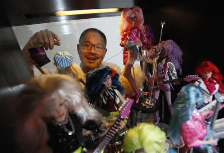 Barbie collector Jian Yang talks about his Barbie Jem and the Holograms collection at his home in Singapore September 2, 2013. REUTERS/Edgar Su