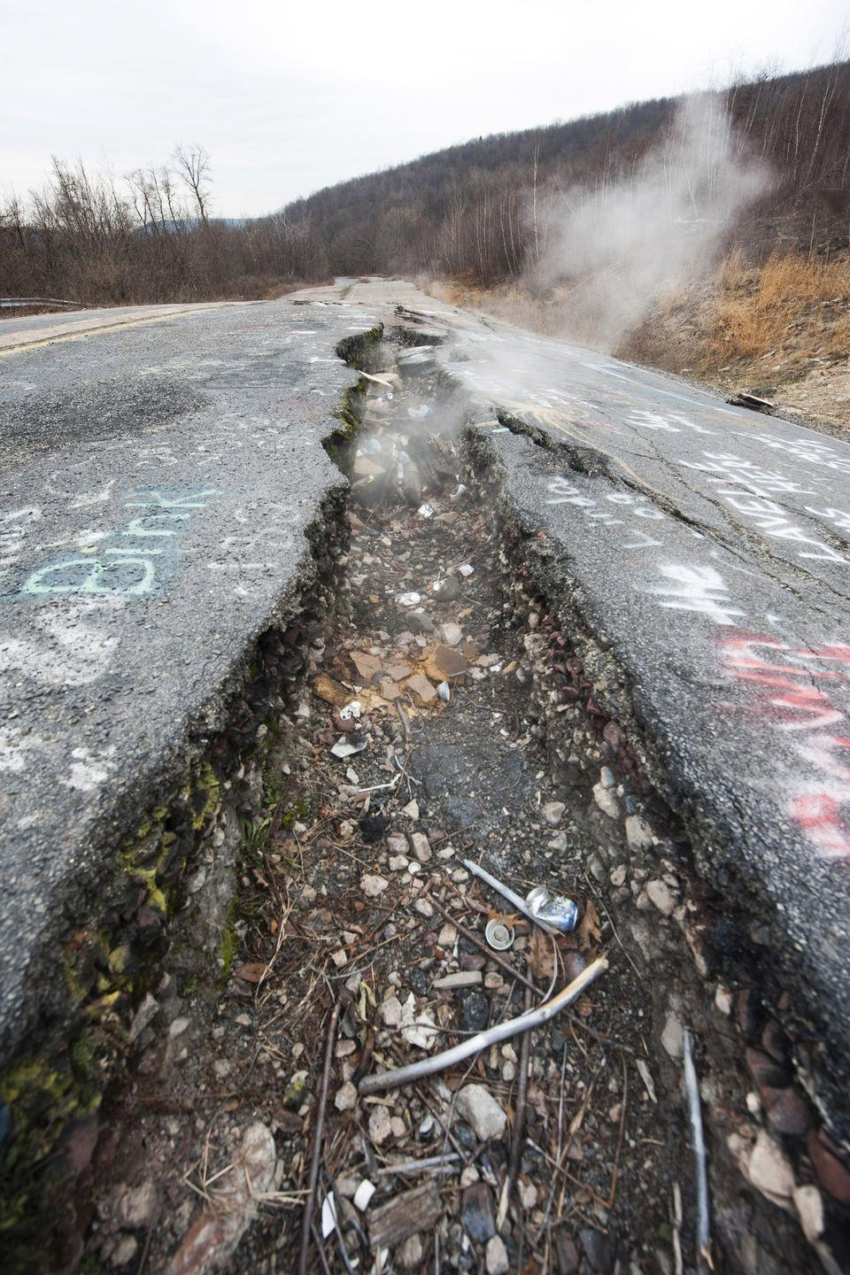 <p><strong>Population:</strong> 10</p><p>There's been an underground coal fire burning for more than 50 years, which has caused this huge hole in the main road in this small town.</p>