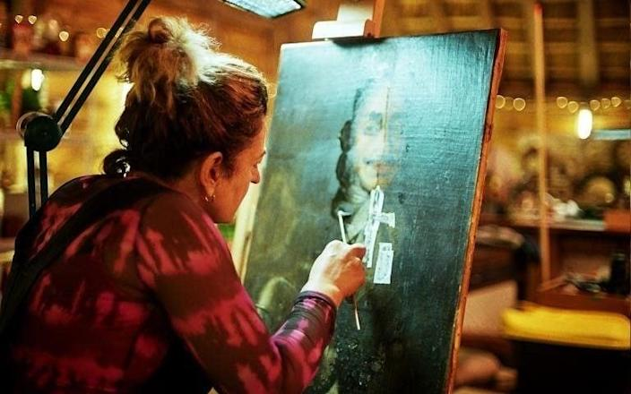 Lucia Scalisi, the show's painting conservator, cleans and restores the work - BBC