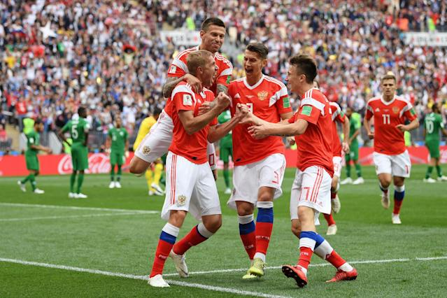 <p>Iury Gazinsky celebrates with his Russian teammates after putting the host nation ahead in the Group A fixture. (Getty) </p>