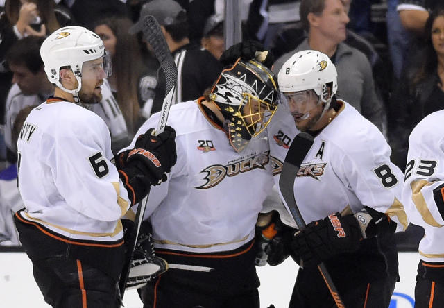 Anaheim Ducks goalie Jonas Hiller, center, of Switzerland, is congratulated by right wing Teemu Selanne, right, of Finland, and defenseman Ben Lovejoy after Game 3 of an NHL hockey second-round Stanley Cup playoff series against the Los Angeles Kings, Thursday, May 8, 2014, in Los Angeles. The Ducks won 3-2. (AP Photo/Mark J. Terrill)