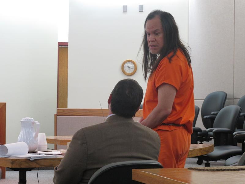 John Marvin Jr., looks down at his attorney, Eric Hedland, as Marvin addresses the court prior to his sentencing on Friday, April 5, 2013, in Juneau, Alaska. Marvin was sentenced to two consecutive sentences of 99 years in the deaths of two police officers. (AP Photo/Becky Bohrer)